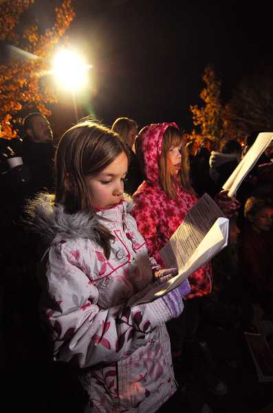 by: REVIEW FILE PHOTO:VERN UYETAKE - The community is invited to join the fun of the annual tree lighting on Friday starting at 5:30 p.m. at Bigelow Plaza. Following the tree lighting there, walk down to Millennium Plaza Park for more songs, music and holiday fun.