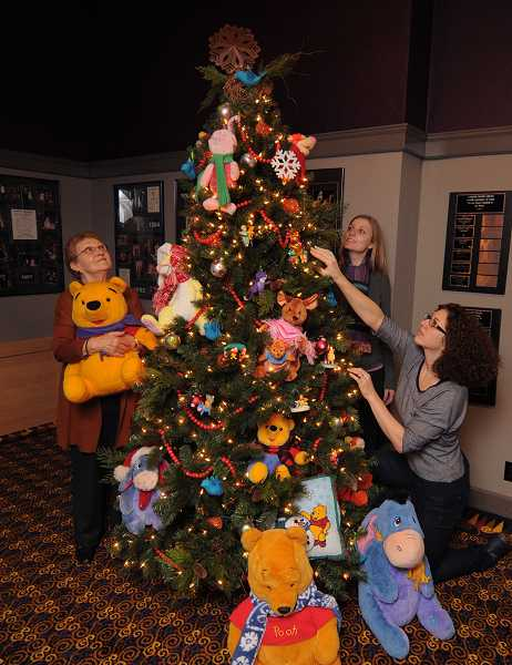 by: REVIEW PHOTO: VERN UYETAKE - Toni Tringolo, membership and development director of Lakewood Center for the Arts, shows off ornaments on one of the five trees to be auctioned at Lakewood in Lights, the annual holiday gala of the Lakewood Theatre Company, to be held Dec. 3. Tickets are on sale now.