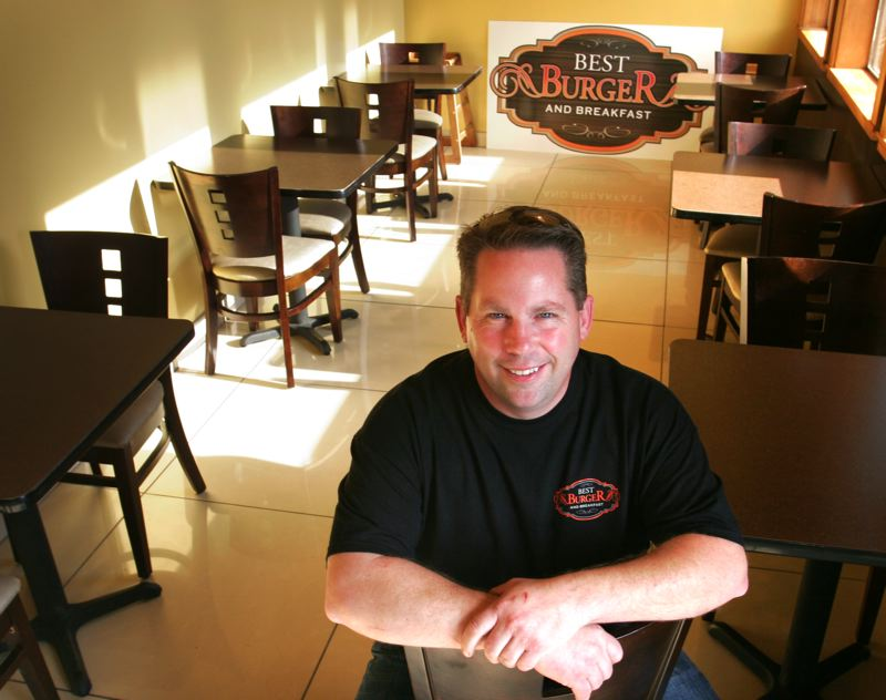 by: OUTLOOK PHOTO: JIM CLARK - OUTLOOK PHOTO: JIM CLARK Best Burger owner John Cartisser infused a rustic decor for his first brick and mortar table-service restaurant.