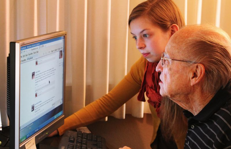 by: OUTLOOK PHOTO: ANNE ENDICOTT - Sarah Yates spends one Saturday each month teaching computer skills to seniors at Gresham Manor. Student Morris Portin, 92, is learning Facebook.
