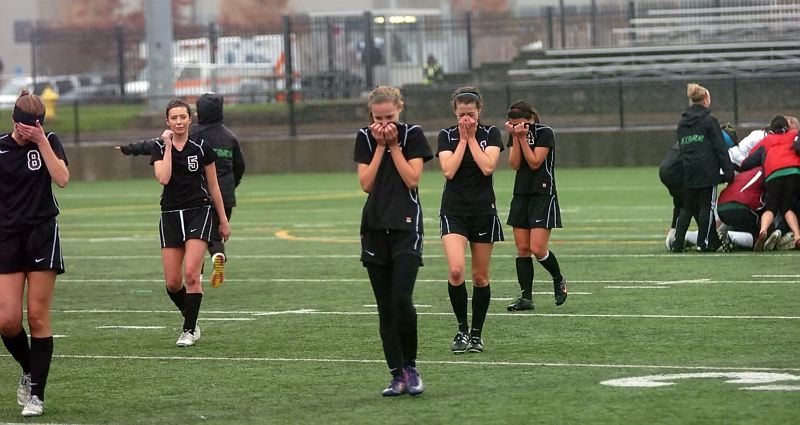 by: DAN BROOD - EMOTIONS -- Members of the Sherwood girls soccer team, including (from left) Carley Mills, Meghan Schoen, Allison Schwarm, Jessica Imbrie and Annie Govig are overcome with emotion at the end of Saturday's state title match.