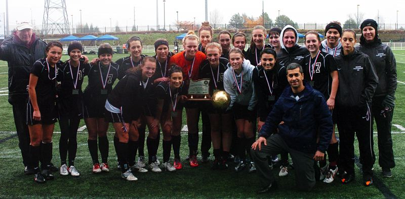 by: DAN BROOD - TROPHY TIME -- The Sherwood girls soccer team gathers around the Class 5A second-place trophy.
