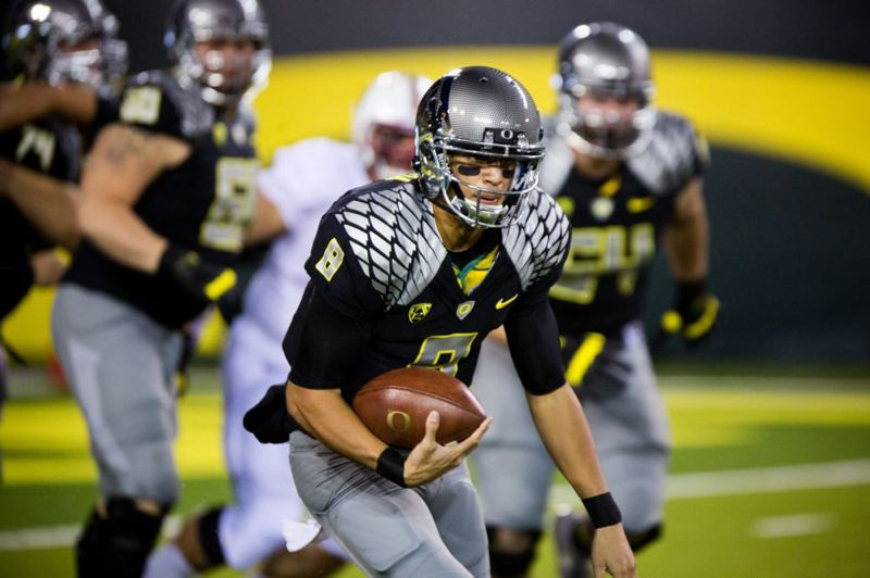 by: TRIBUNE PHOTO: CHRISTOPHE ONSTOTT - Oregon quarterback Marcus Mariota breaks out for a long run in the frist quarter against Stanford Saturday at Autzen Stadium.