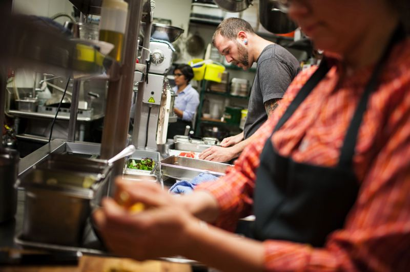 by: TRIBUNE PHOTO: CHRISTOPHER ONSTOTT - Cooks Matt Alspach and Tamara Edens prep food in the kitchen of Grain and Gristle. Employees at the Northeast Portland restaurant will be  accruing sick pay as of January first, implemented by the owners.