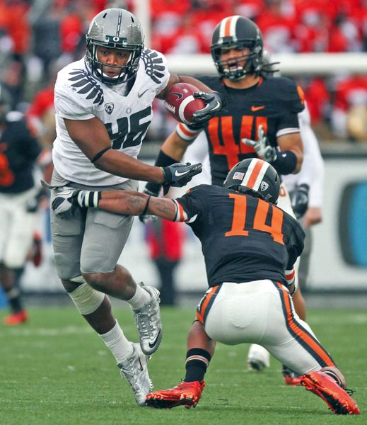 by: TRIBUNE FILE PHOTO: JAIME VALDEZ - The last time the Oregon Ducks were at Reser Stadium, in 2010, backup linebacker Michael Clay broke through the arms of Oregon State's Jordan Poyer during a 64-yard fake punt run as Oregon won 37-20 to clinch a spot in the national championship game. Clay, now a senior starter, and the Ducks return to Corvallis on Saturday.