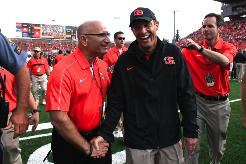 by: TRIBUNE PHOTO: JAIME VALDEZ - Oregon State coach Mike Riley (right) gets congratulations from athletic director Bob De Carolis after the season-opening victory over Wisconsin.