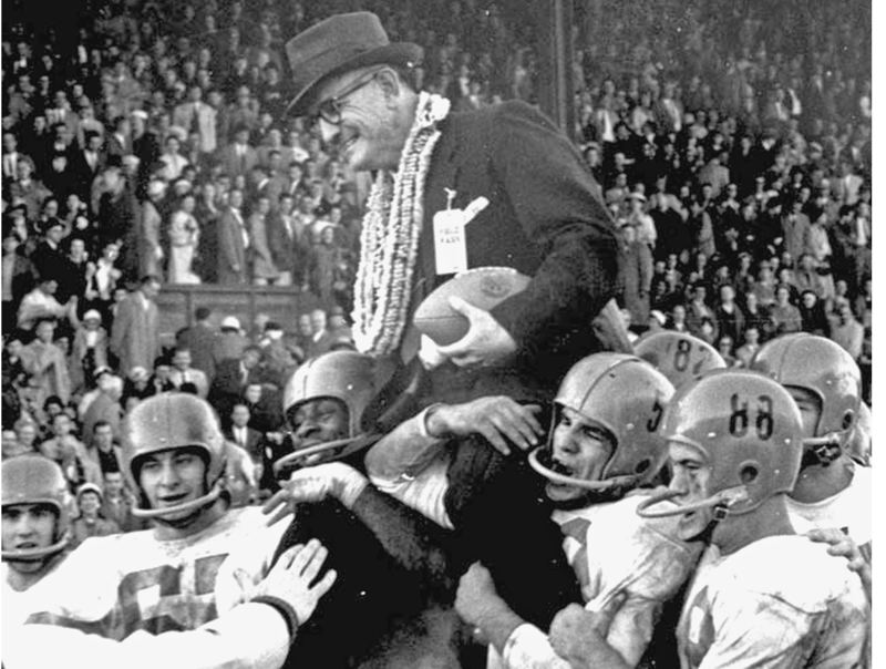 by: COURTESY OF OREGON STATE UNIVERSITY - Coach Tommy Prothro gets carried off the field by his players after the Beavers' 10-7 victory in 1957 - which gave OSU a share of the Pacific Coast Conference title with Oregon (both 6-2). The Ducks went to the Rose Bowl, however, because the Beavers had gone the year before and rules at the time prohibited repeat trips.