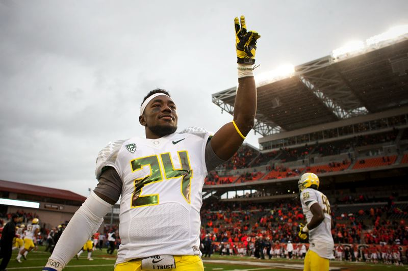 by: TRIBUNE PHOTO: CHRISTOPHER ONSTOTT - Kenjon Barner celebrates the Oregon Ducks' 48-24 win over Oregon State.