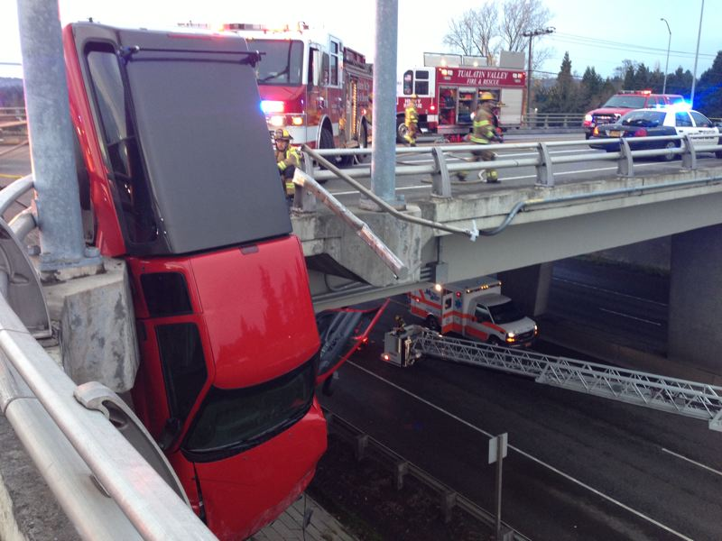 by: TUALATIN VALLEY FIRE AND RESCUE - Truck dangled over 217 at Denny after Saturday afternoon crash.