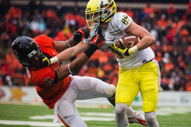 by: TRIBUNE PHOTO: CHRISTOPHER ONSTOTT - Oregon receiver Will Murphy pushes Oregon State defender Tyrequek Zimmerman after a catch in Saturday's Civil War at Reser Stadium.