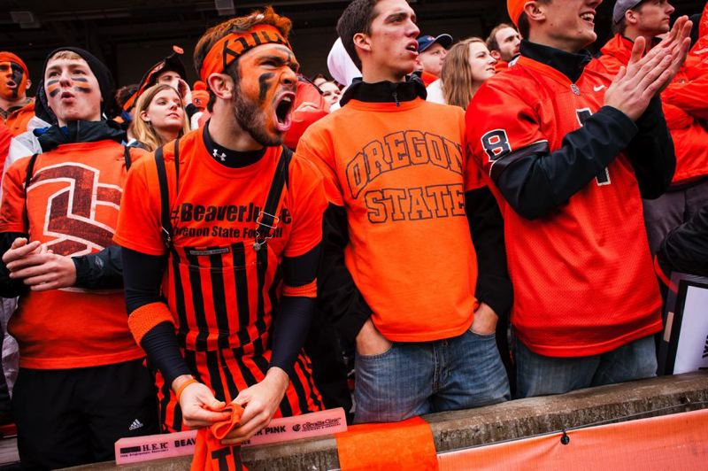 by: TRIBUNE PHOTO: CHRISTOPHER ONSTOTT - Oregon State fans express their displeasure with an official's call.