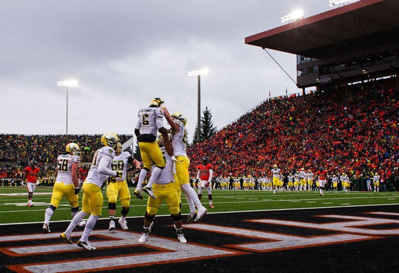 by: TRIBUNE PHOTO: CHRISTOPHER ONSTOTT - Fellow Ducks surround De'Anthony Thomas after one of his three rushing touchdowns in Oregon's 48-24 Civil War triumph at Oregon State on Saturday.