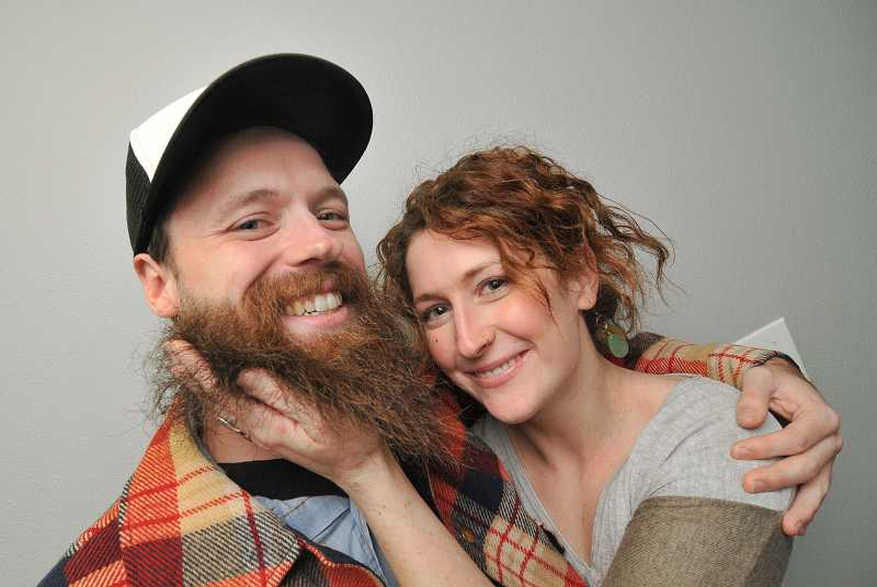 by: REVIEW, TIDINGS PHOTO: VERN UYETAKE - Cait Kelly happily nuzzles her face in Trevor Woolman's beard. With Kelly's help, Woolman challenged the best beards in the world.