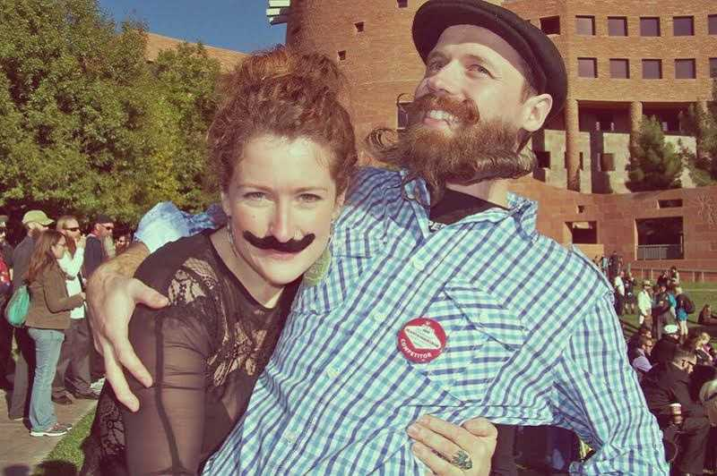 by: SUBMITTED PHOTO - Trevor Woolman gets a big hug from his girlfriend Cait Kelly, who fortunately happens to be a giant fan of beards.