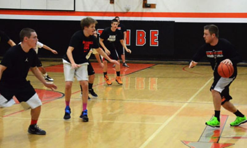 by: JOHN BREWINGTON - Scappoose Coach Rahim Tufts runs a drill during practice at Scappoose High recently. The Indians host St. Helens this Wednesday.