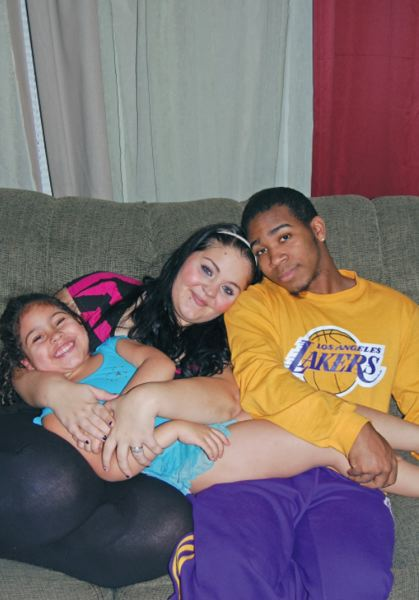 by: SUBMITTED PHOTO - Courtney Polk and Antoine Carney cuddle with their daughter, Anaya Polk-Carney.
