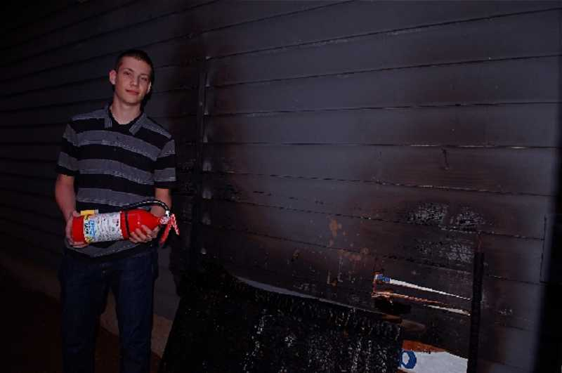 by: SUBMITTED - Austin Sloop, 17, of West Linn put out a fire near his family's garage and chicken coop with a fire extinguisher and garden hose.