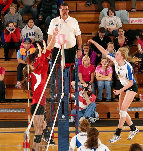 by: PAUL MCCARTHY, ALASKA ATHLETICS - Sam Harthun (11) of Oregon City battles at the net for the University of Alaska in an Oct. 18 match with Western Oregon. Harthun was honored recently as Great Northwest Athletic Conference volleyball Co-Rookie of the Year.