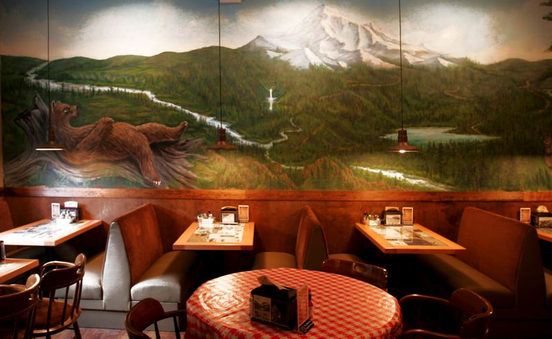 by: POST PHOTO: JIM CLARK - A mural of Mount Hood is displayed inside the Ivy Bear Family Pizzeria.