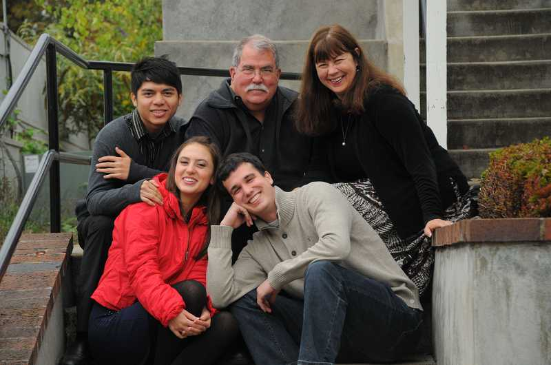 by: REVIEW PHOTO: VERN UYETAKE - From left, Asil Kurundarath, Yana Tsyplakova and Philip Rothhardt pose with their host parents, Bruce and Rosalie Broding, of Lake Oswego. The foreign exchange students recently met for the first time in Lake Oswego and clicked instantly.