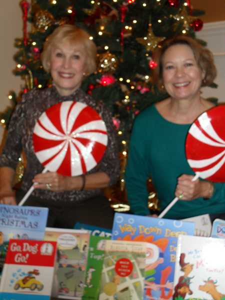 by: BARB RANDALL - Joann Frankel, left, president of the Lakewood Center Associates, and Jeanne Denton, past president and current board member, show some of the ornaments they will use to decorate a tree that will be auctioned at the Lakewood in Lights gala Dec. 3. The tree will include more than 100 books, which  the women hope will be donated with the tree to a women's or children's center or hospital.