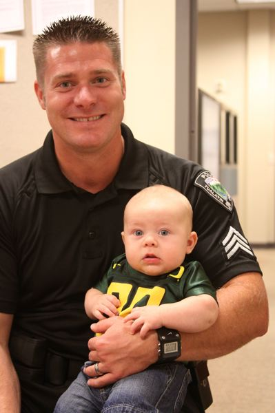 by: SUBMITTED PHOTO - Thanks to cutting-edge orthopedic surgery, Sgt. Nate Cooper recovered from a potentially career-ending injury that happened on the job in January 2010. Here, Sgt. Cooper poses with his son.