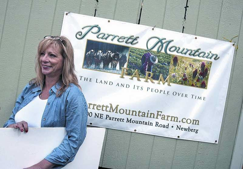 by: JAIME VALDEZ - Elizabeth Rhode shows a reporter her plans to create a pioneer-style farm and historical center on 418 acres on Parrett Mountain in 2007.