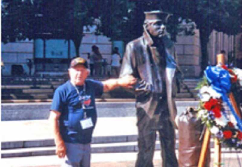 by: COURTESY OF JOSEPH DOYON - STATUES EVERYWHERE - Joseph Doyon, who served in the Navy during WWII, stands by the statue of The Lone Sailor outside the Navy Memorial in Washington, D.C., one of many stops his group made on their September trip.