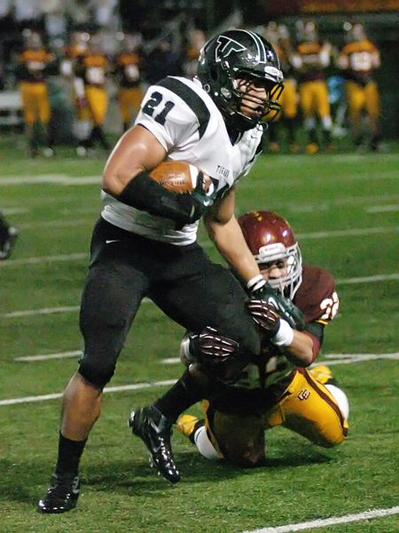 by: DAN BROOD - BIG NIGHT -- Tigard junior A.J. Hotchkins provided some strong blocking and key catches in the win over Central Catholic.