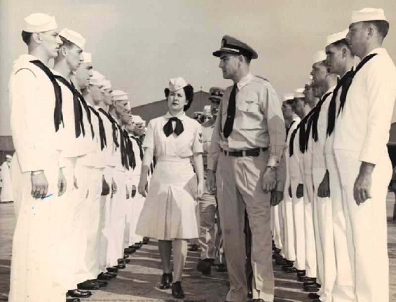 by: COURTESY OF MARINA GARDINER - PROMOTED - Marina Gardiner, accompanying a Navy captain during an inspection during WWII, joined the WAVES as a seaman and became a yeoman second class.