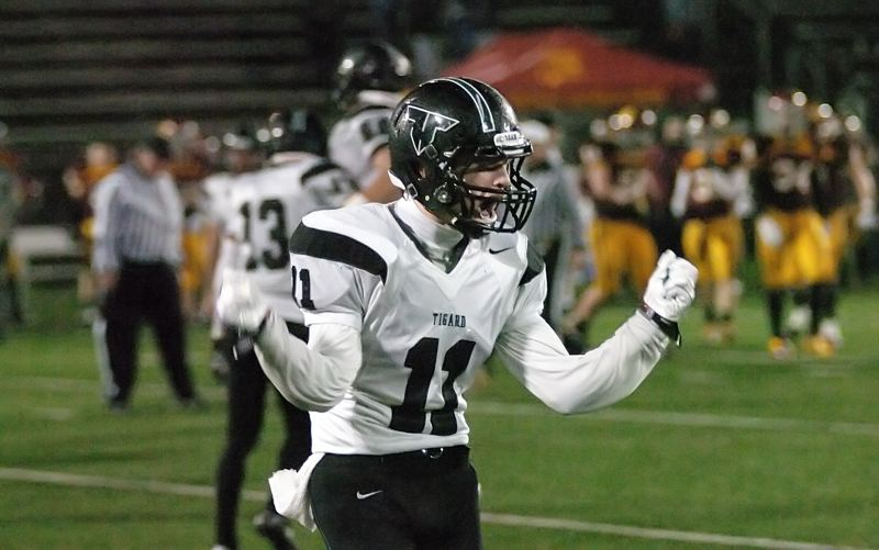 by: DAN BROOD - DEFENSE RULES -- Tigard senior defensive back Anthony Consolo celebrates following a fourth-quarter defensive stand.