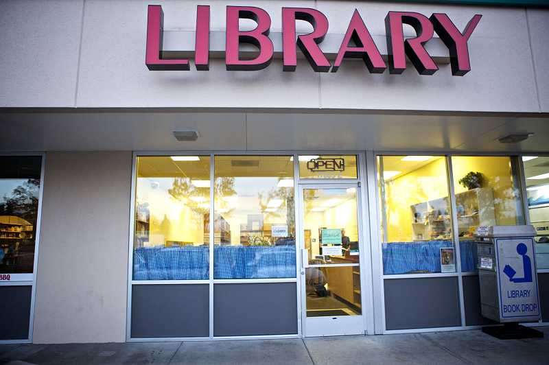 by: JAIME VALDEZ - The new Aloha Community Library is tucked into the Bales Thriftway shopping center in Aloha.