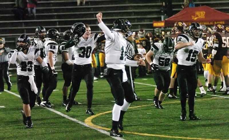 by: DAN BROOD - READY FOR MORE -- The Tigard High School football team, including Zach Floyd (23), Conner Olson (30), Jett Even (14), Ethan Lange (52) and Robby Chabreck (15) celebrates following the win over Central Catholic.