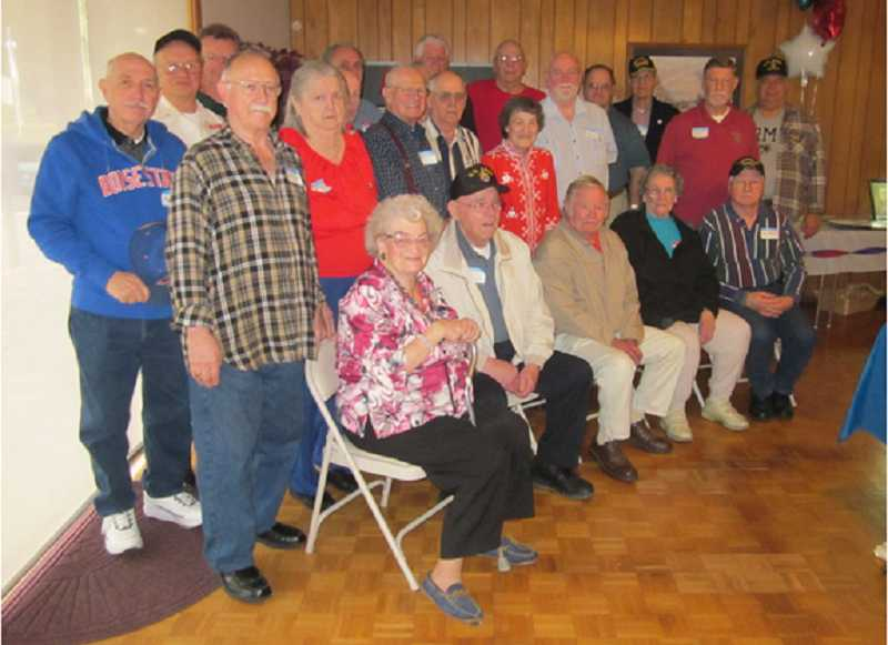by: BARBARA SHERMAN - PROUD TO SERVE - All the veterans living in the Royal Villas community who were present gathered together for a group photo in the Clubhouse following a Nov. 10 breakfast.