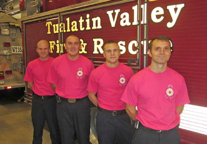 by: BARBARA SHERMAN - READY TO ROLL - This Tualatin Valley Fire & Rescue Station 35 crew in King City Is happy to support finding a cure for breast cancer: From left are firefighter John Sconce, Capt. Troy Spisla, firefighter Kody Fordyce and engineer/driver Kurt Koudelka.