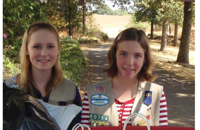 by: SUBMITTED PHOTO  - Eighth-grade Girl Scouts Johanna Parker and Sophie Bohley work toward their silver award with costume drive.
