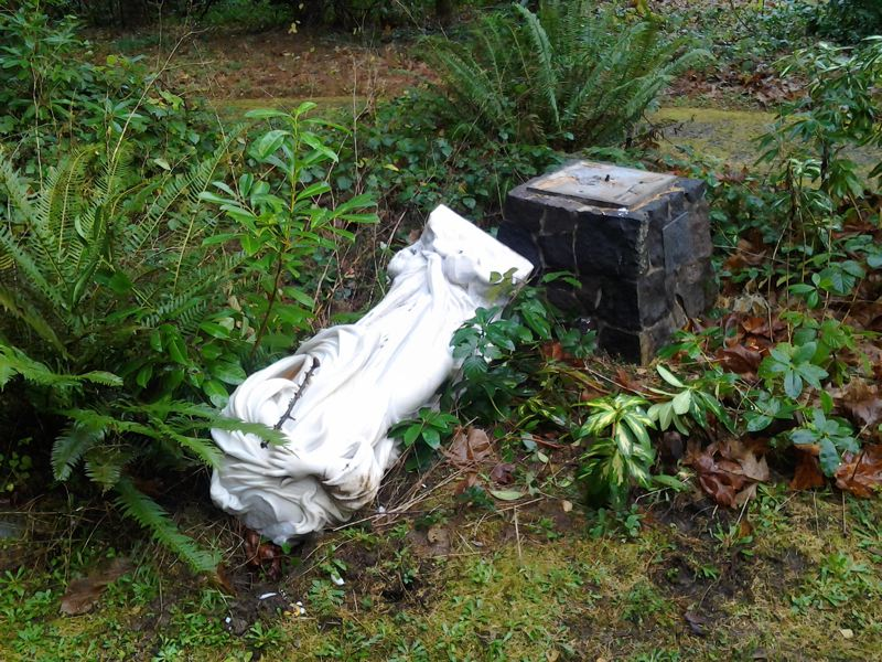 by: PORTLAND POLICE BUREAU - Statue of Joseph toppled and vandalized at the Grotto.