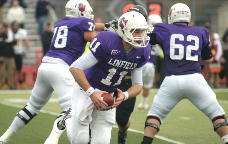 by: PAMPLIN MEDIA GROUP: DAVID BALL - Linfield QB Mickey Inns rolls out to make a throw during the first half of Saturdays 31-24 loss to UW-Oshkosh in the D3 quarterfinals.