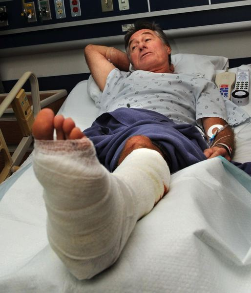 by: COURTESY OF THE MAUI NEWS: MATTHEW THAYER PHOTO  - Lake Oswegan Tom Kennedy talked about being attacked by a shark Friday afternoon before being wheeled into surgery at Maui Memorial Medical Center.
