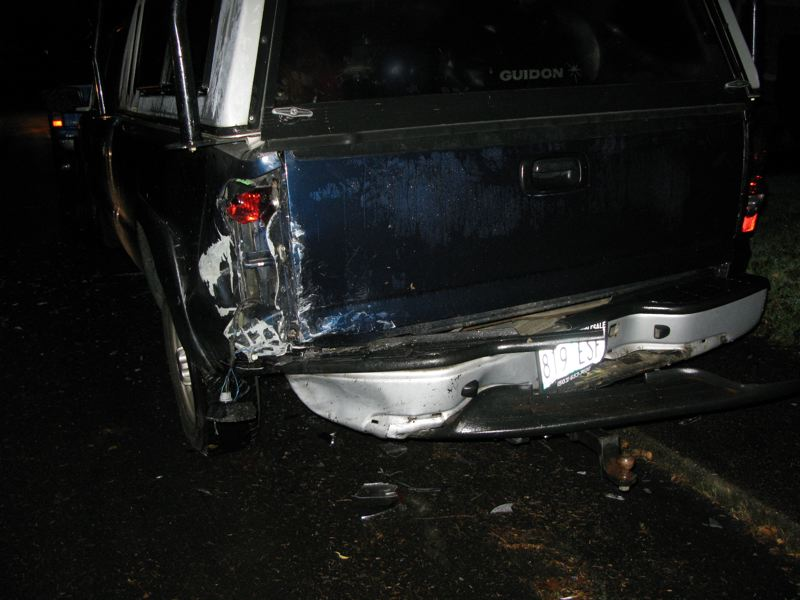by: MILWAUKIE POLICE DEPARTMENT - A hit-and-run driver Sunday morning damages a parked truck in Milwaukie.
