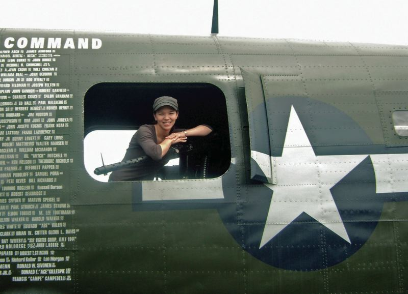 by: SUBMITTED - Local author Kristina McMorris will speak at the Pearl Harbor event; she is pictured above in a B24 bomber from the early 1940s.