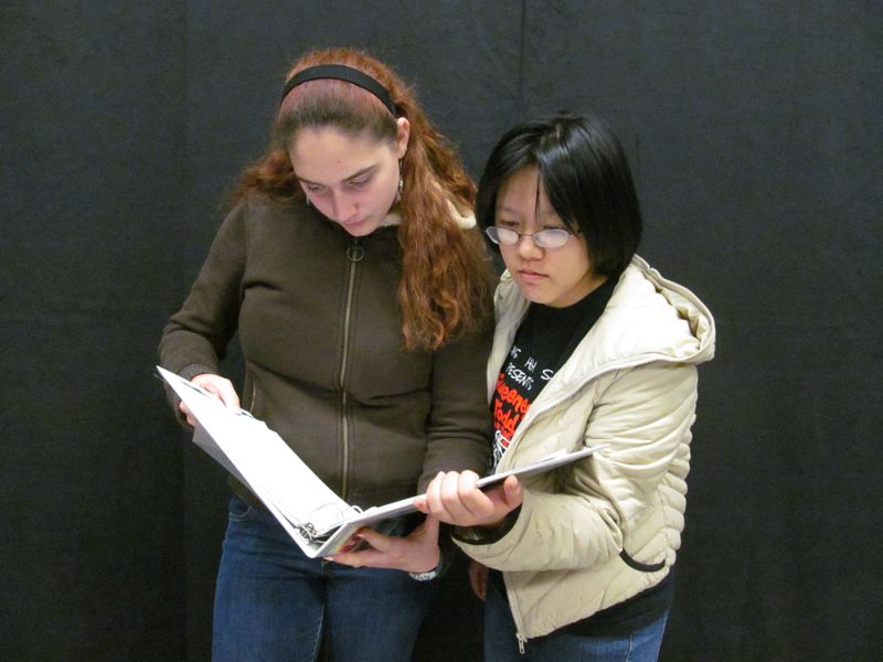 by: PHOTO BY ELLEN SPITALERI - CHS Thespians Mychal Elmore and Christine Zhao look over a musical script.