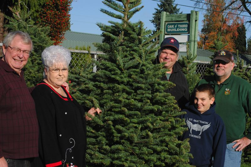 by: HILLSBORO TRIBUNE PHOTO: STEPHANIE HAUGEN - The St. Matthew tree lot requires a lot of volunteers, including (from left to right) Ron and Rochelle MacDonald, Frank Lux and Nicholas and Dave Anderson.