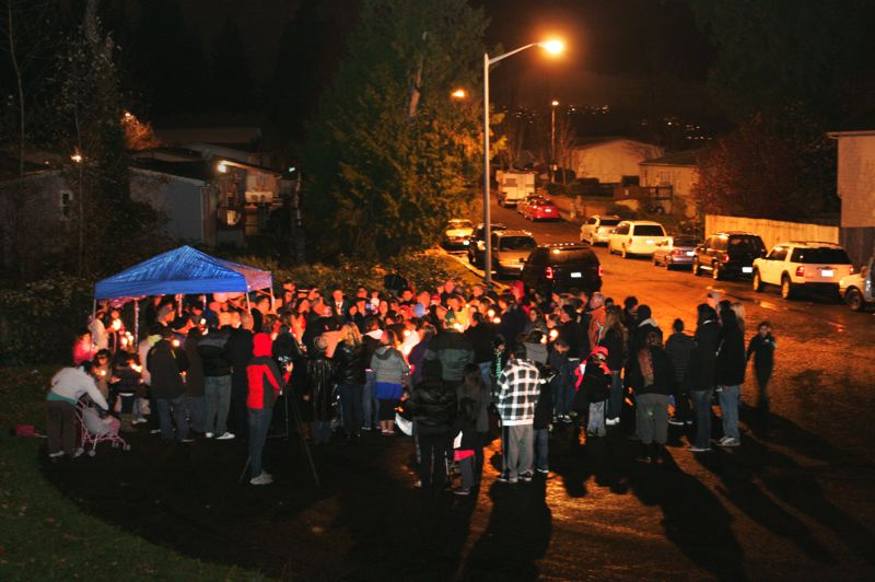 by: STAFF PHOTO: JIM CLARK - Dozens gathered for a candlelight vigil to honor the memory of 10-year-old Miranda Crockett Saturday evening at a cul-de-sac outside Kings Garden Apartments where Miranda had lived.