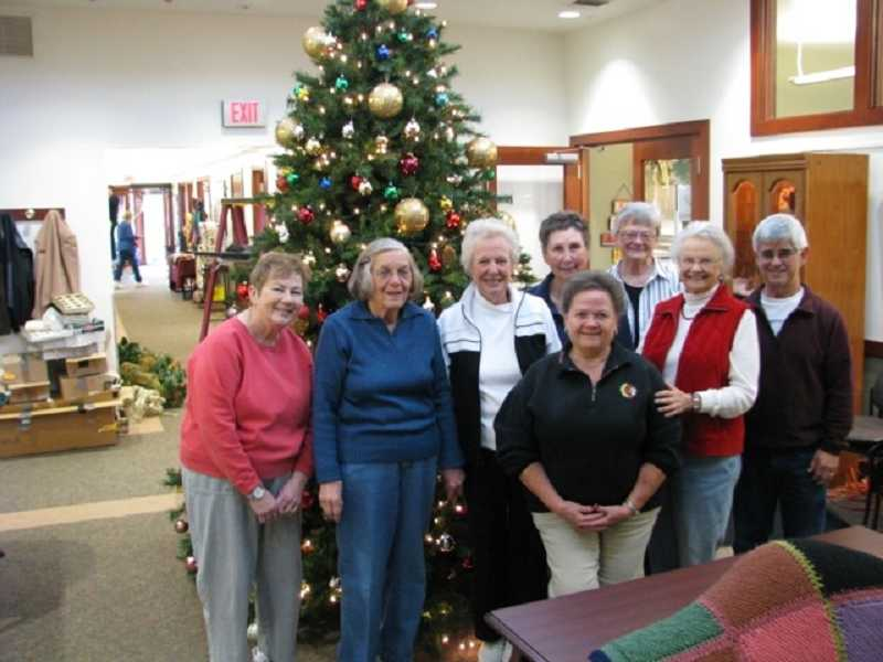 by: SUBMITTED PHOTO  - Holiday decorators, from left, Sally Olson, Vi Quella, Joyce Brown, Norma Juhr, Rose Ek, Margaret Dejardin, Wanda Vilter, and Paul Brown. Not present are decorators Mary Hill, Mike Lindner, Jay Rice and Irene Jones.