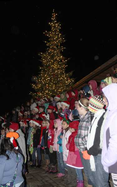 by: JON HOUSE - Children sing in front of Sherwood's Christmas tree on Saturday night.