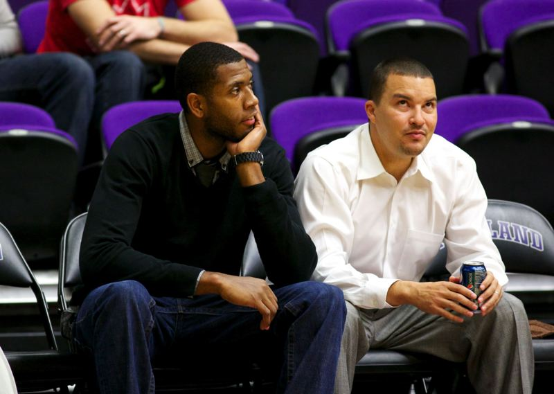 by: TRIBUNE PHOTO: JAIME VALDEZ - Mike Moser (left) can only watch as his UNLV teammates beat the Portland Pilots 68-60 Tuesday at Chiles Center. UNLV, ranked 18th, improved to 6-1.