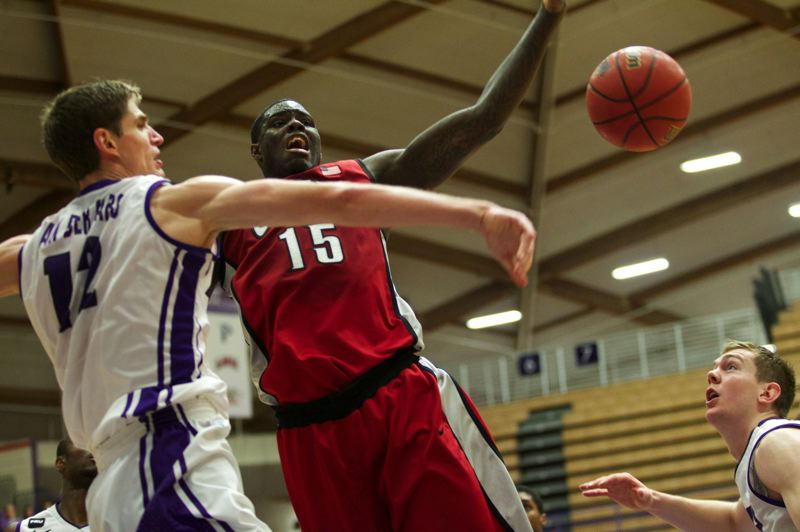 by: TRIBUNE PHOTO: JAIME VALDEZ - Portland's Thomas van der Mars (left) swats away a shot by UNLV's Anthony Bennett.