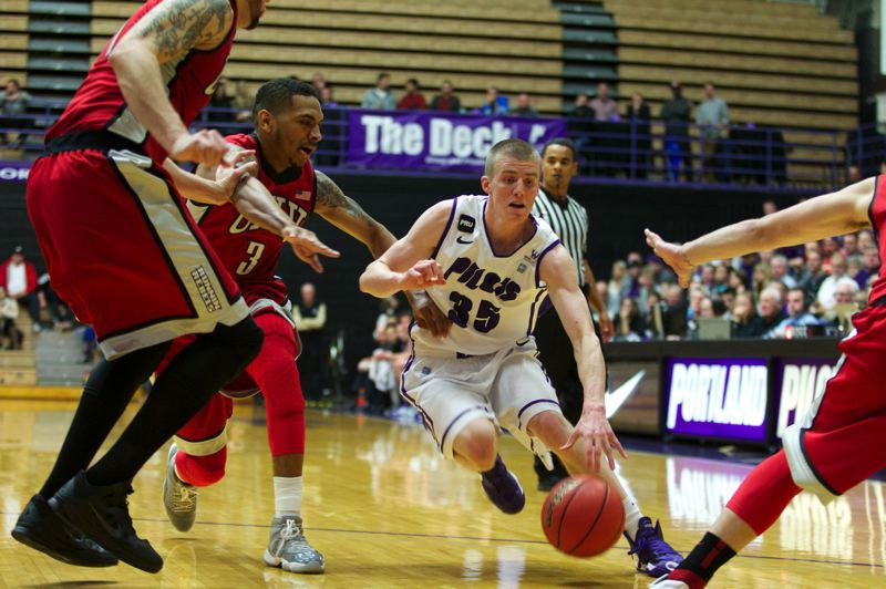 by: TRIBUNE PHOTO: JAIME VALDEZ - Guard David Carr of the Portland Pilots looks for a seam in the UNLV defense.