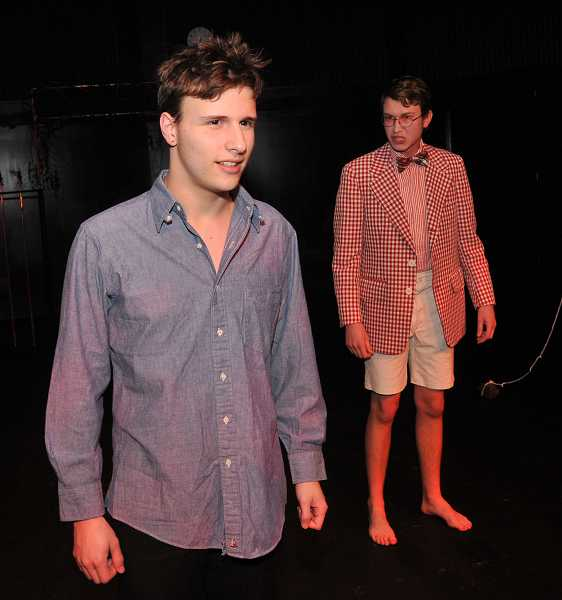 by: TIDINGS PHOTO: VERN UYETAKE  - Ian Stout is Orpheus, left, and Griffin Ollar is Lord of the Underworld.